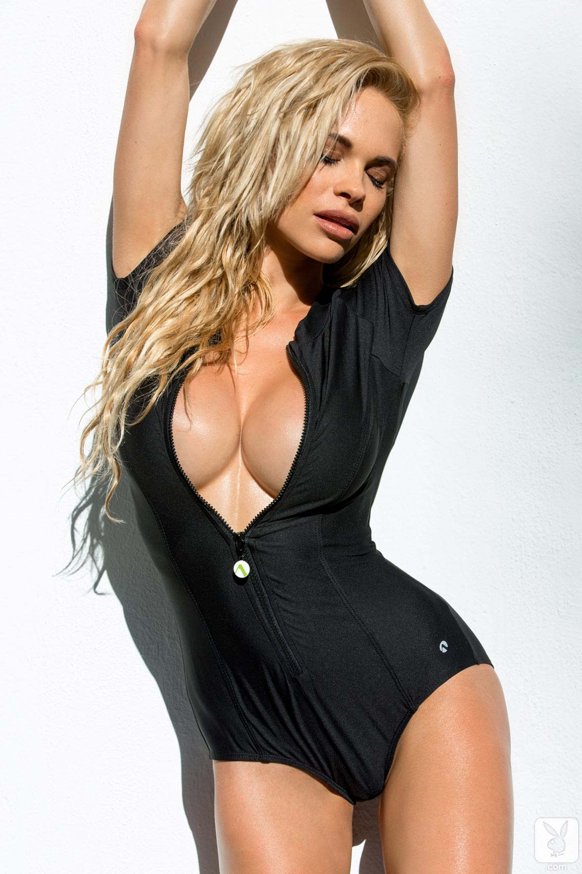 http://www.centerfoldsblog.com/wp-content/uploads/2014/06/playboy-playmate-dani-mathers-removes-her-black-wetsuit-near-the-pool.jpg